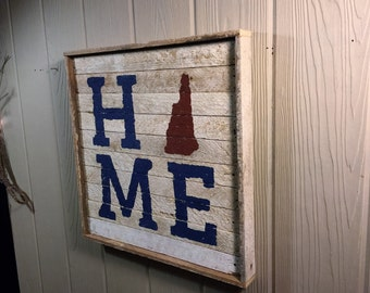 Rustic Home wall hanging is made out of reclaimed wood.