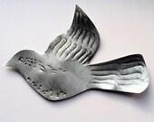 Little silver metal bird