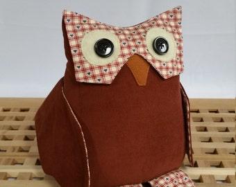 Owl doorstop. Russet red