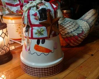 Terracotta pot snowman