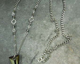 Necklace, edgy, gothic, rock and roll style, black Swarovski crystal spike, stainless steel chain with sterling and Swarovski crystals.