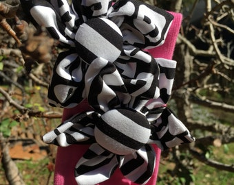 Pink headband with 2 black and white fabric flowers
