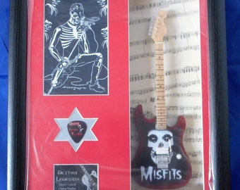 The misfits framed tribute guitar and plectrum display