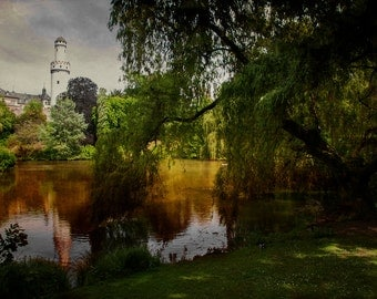 photographic image of a view of the castle in Bad Homburg which is reflected in the lake, surrounded by a beautiful garden
