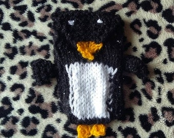 Hand knitted, cute, penguin phone case.
