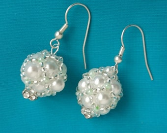 Earrings beaded out of beads with rhinestone.