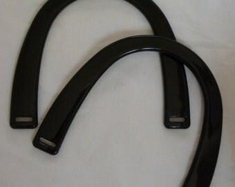 Black plastic handbag handles