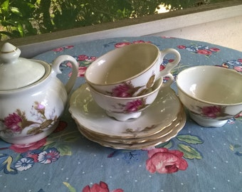 Shabby Chic vintage rose china ,three teacups and sugar bowl