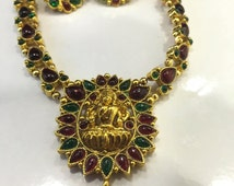 Handmade metal jewelry set with lakshmi faced pendant