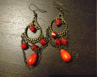 Brass earrings with red beads