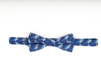 Blue bow tie with whales pattern