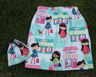 Fun summer skirt for toddler.  Elasticated waist.  Fun and colourful fabric. Length 12 in (30 cm)
