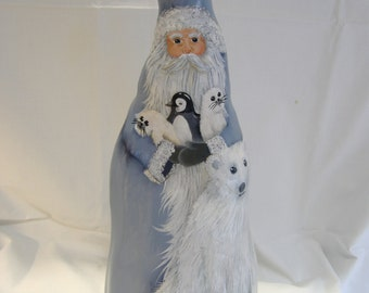 Hand painted cypress knee santa with polar bear, baby seals, and penguin.