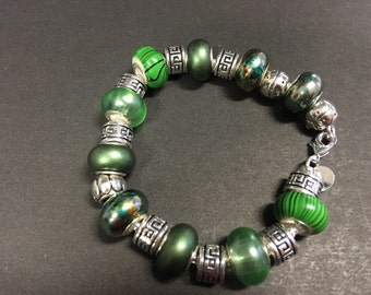 Sterling Silver Bracelet with varied green glass beads and silver spacers.