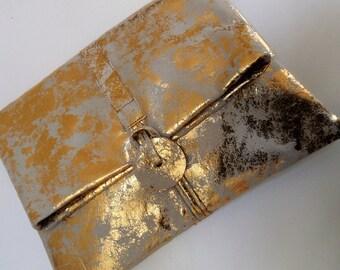Distressed metallic gold soft clutch bag
