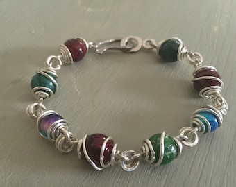 Wire wrapped violet, red and green