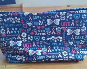 "10""x5"" breast cancer awareness makeup bag with velcro closure."