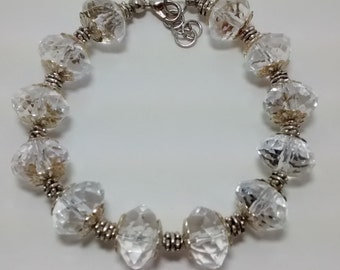Crystal Clear Bead Bracelet Accented with Antiqued Silver Lacy Caps and Silver Spacers