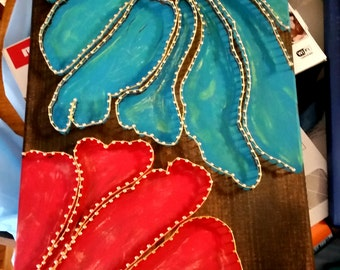 Red and blue painted and string art.