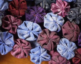 Antique silk textile yoyos - scrunches of silk sewn together to make an interesting silk fabric art piece