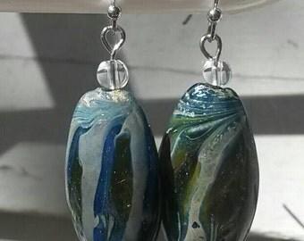Striking blue and green swirl glass bead dangle earrings