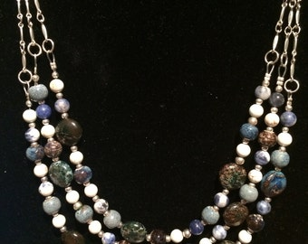 Handmade three strand, multi-bead, blue, and white necklace