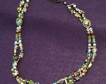 Multi-colored, multi-pattern double strand, hand strung glass beaded necklace