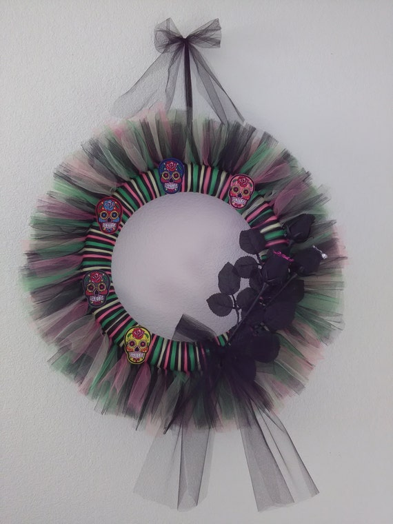 celebrate the day of the dead year round with this colorful sugar skull wreath this tulle wreath comes with 5 assorted color sugar skulls and 3 black