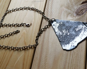 Zinc engraved pendant necklace.