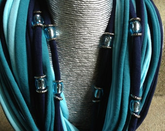 Designer spaghetti scarf in teals and navy