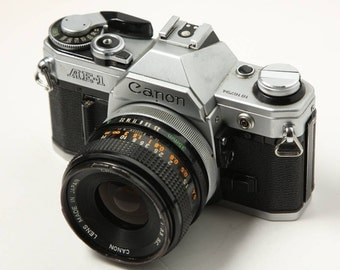 Canon AE-1 SLR with Canon FD 35mm f/3.5 S.C. Lens