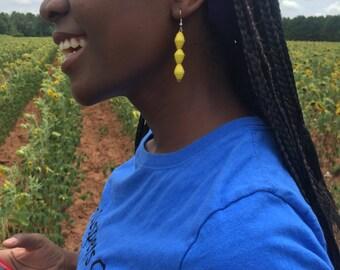 Yellow paper bead ear-rings handmade  in Uganda.