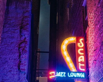 The Neon Scat Jazz Lounge Sign Lights up a Dark Alley in Downtown Fort Worth Texas Near Sundance Square