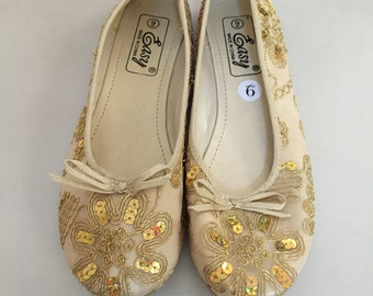 Golden costume shoes