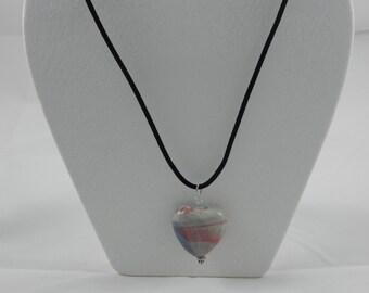 Porcelain heart pendant on black necklace