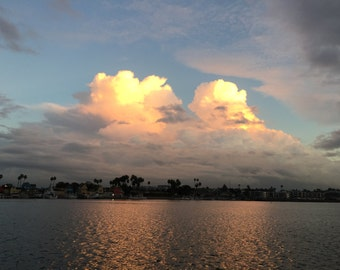 Sunlit Clouds on the water