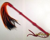 Long red handled tsetse fly swatter