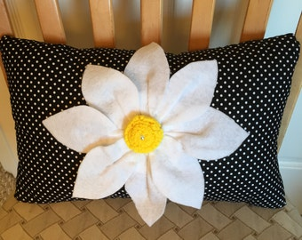 Black and white polka dot pillow and white felt flower