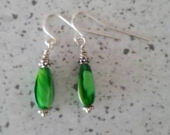 Green beaded earrings.