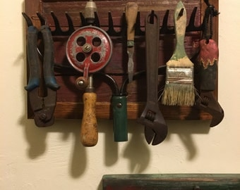 Old Tools Displayed on Barn Wood