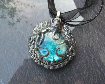 Magical pendant in old silver with blue stone #004