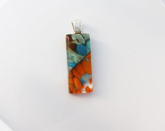 Beautiful layers in a Fused Glass Pebble Pendant with Silver Plated Bail: Orange and Blue