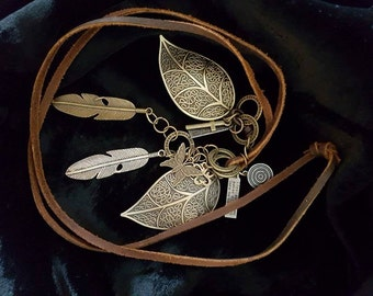 Very long bronze leaf and feather leather necklace.