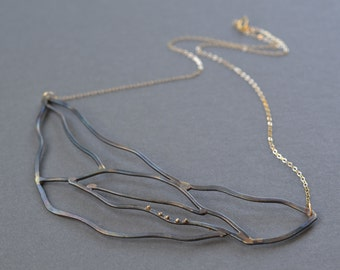 Linear Web Necklace- steel and gold bib necklace