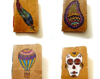 Recycled Upcyled Paper Grocery Bag Handbound Notebooks with Hand Drawn Art Feather Sugar Skull Hot Air Balloon Paisley