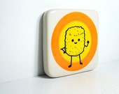 tile featuring Mr.T.Tot, waving hello, on a color block of orange and yellow. Ready to ship.
