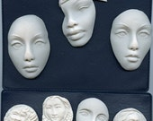 a 14 piece lot of unpainted face cabs. Reserved for Camille Only