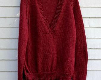 Man's V neck Sweater, maroon, size medium.