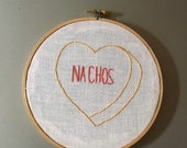 Nachos - hand drawn and embroidered converstion hearts hanging