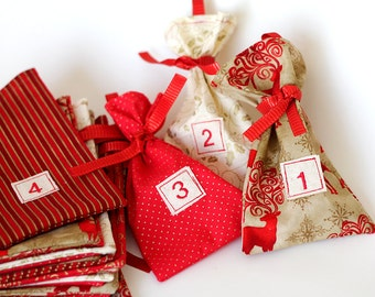 set of festive Christmas Advent, fabric bag, Calendar. Count down December. 12 days of Christmas. red Deer and metallic gold gift bags.
